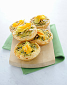 Puff pastry tartlets with courgette and courgette flowers