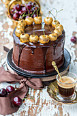 Chocolate cake with golden cherries