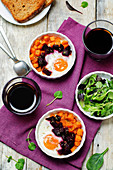 Beet Sweet potato baked eggs on a wood background