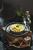 Savoury tartlet with courgette and parmesan in a baking dish