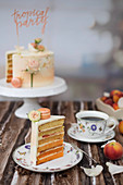 A festive peach cake with peach macaroons and roses