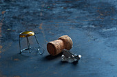 Champagne corks, an agraffe and silver foil