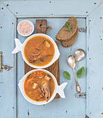 French Bouillabaisse fish tomato soup with salmon fillet, shrimp and spices