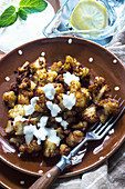 Oriental-style fried cauliflower with yoghurt sauce
