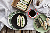 Sushi sandwiches with tuna fish cream and lettuce leaves