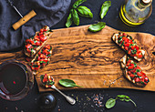Tomato and basil bruschetta with glass of red wine