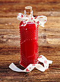 Homemade raspberry liqueur as a Christmas present