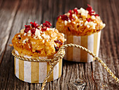 Pecan nut and cranberry muffins in paper cases