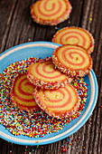 Christmas spiral biscuits with colourful sugar sprinkles