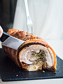 Sliced porchetta (pork belly roll, Italy)
