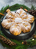 Sweet Christmas bread in a star shape with cinnamon and almonds