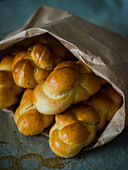 Brioche plaits in a paper bag