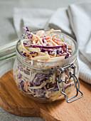 Coleslaw in a flip-top jar