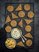 Homemade crackers with seeds, almonds and Parmesan