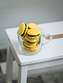 Yellow macaroons with chocolate ganache