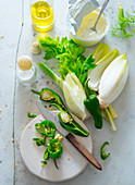 An arrangement of ingredients with chicory, fennel, peperoni, yoghurt and olive oil