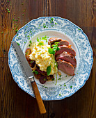Duck breast with mashed potatoes and roasted onions
