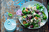 Greek salad with pimientos de padrons, feta cheese, spinach, olives and walnuts