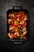 Oven-roasted chicken with peppers (seen from above)
