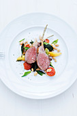 Saddle of lamb à la toscane with potatoes, cherry tomatoes, spring onions and white beans