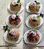 Vegan redcurrant and hazelnut Bundt cakes with berry cream