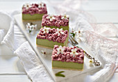 Vegan matcha raspberry crumble slices with white flowers