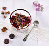 Chocolate crunch with fruits of the forest compote on almond yoghurt with chocolate sweets