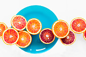 A row of halved Moro blood oranges