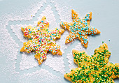 Star-shaped biscuits with colourful sugar sprinkles