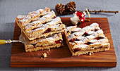 Nutty Christmas shortcrust tarts with raspberry jam