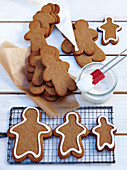 Pepparkakor (gingerbread men, Sweden) being decorated with icing