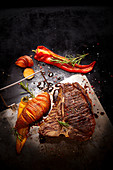 Grilled T-bone steak with hasselback sweet potatos and peppers