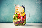 Infused water with fresh organic fruits and berries