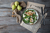Rocket and pear salad with walnuts and Parmesan