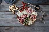 Italian antipasti platter with ham and cheese
