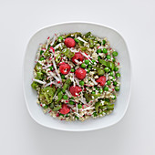 Bulgur salad with green pepperoni and raspberries