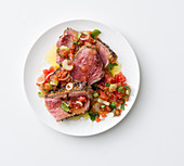Marinated beefsteak with a spicy tomato salsa