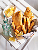 Fish and Chips with vinegar and lemon