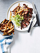 Sirloin steak with red wine sauce and kipfler chips