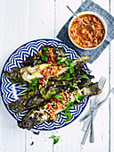 Barbecued whiting with a chilli-nut dressing