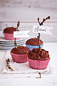 Spiced muffins decorated with name tags on twigs