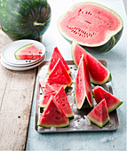 Watermelon and watermelon slices on ice