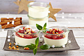 Panna cotta with cinnamon damsons, almond brittle and peppermint in jars
