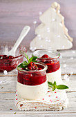 Gingerbread mousse with punch cherries in jars