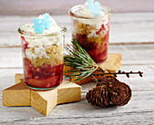 Punch damsons with cinnamon and orange crumble and whipped cream in jars
