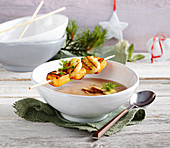 Chestnut soup with Port wine, and anise and grilled scallop and sweet potato skewers