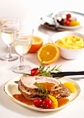Roast pork with polenta, oranges and cherry tomatoes