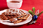 Chocolate waffles with chocolate sauce for Christmas