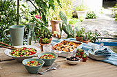 A summer buffet with aubergine lasagne and orecchiette salad with courgette and marjoram pesto