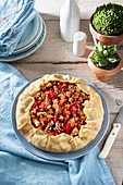 Octopus galette with tomatoes and pepper